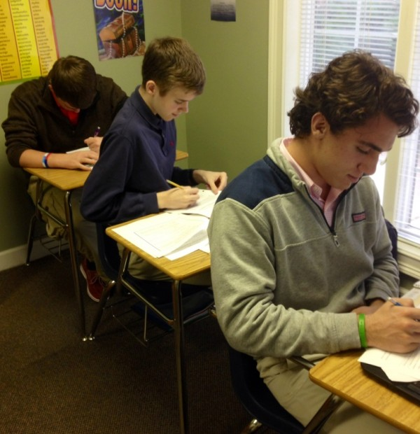 Riley, Mitchell, and Eric working hard on their paper